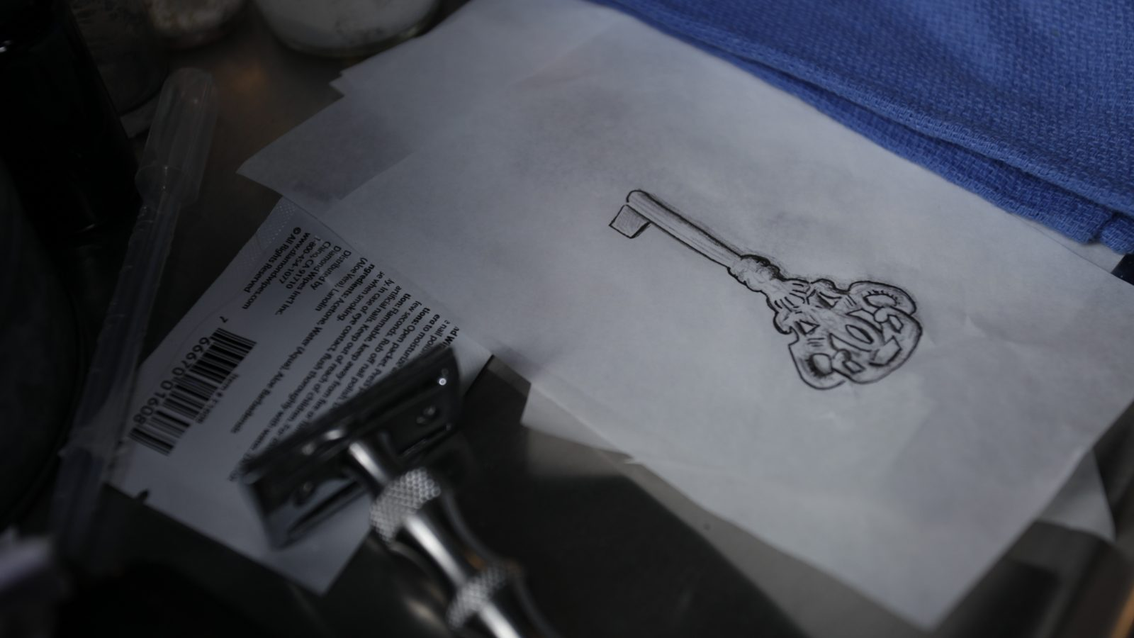 Sketching of a key on a piece of paper