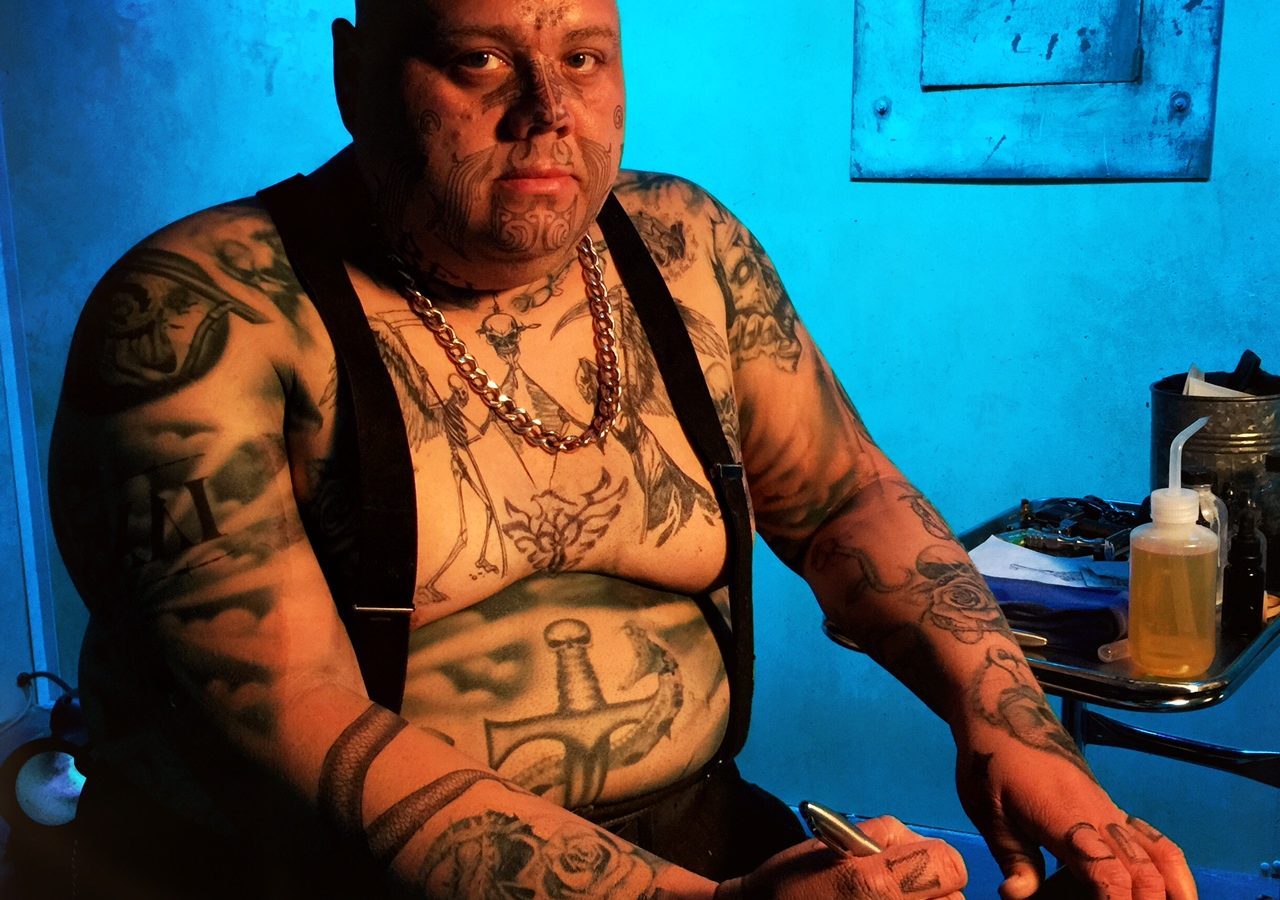 Man covered in tattoos